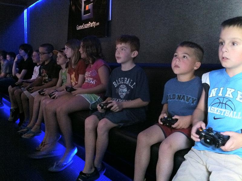 Kids playing inside game truck